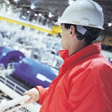 Employee looking over Manufacturing Line